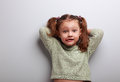 Humor kid girl in fashion blouse posing with funny face Stock Photography