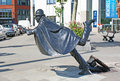 The humorous brussels belgium june tom frantzen's sculpture depicts a policeman about to fall head over heels at place Royalty Free Stock Photo