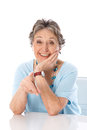 Humorous older lady pointing elder woman isolated on white bac with finger at camera Royalty Free Stock Photography