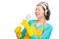 Humorous photo housewife with headphones and a cleaning brush Royalty Free Stock Photo