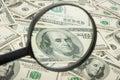 Hundred dollar banknotes under magnifying glass Stock Images