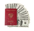 Hundred dollar bills fan with a passport Royalty Free Stock Photos