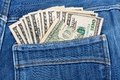 A hundred dollar bills sticking in the back pocket of denim  jeans Royalty Free Stock Photo