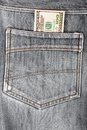A hundred dollar bills sticking in the back pocket  jeans Royalty Free Stock Photo