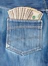 A hundred dollar bills sticking in the back pocket of jeans denim blue Stock Photography