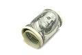 Hundred dollars rolled up on white background Royalty Free Stock Image