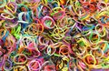 Hundreds of multicolored loom bands loose unwoven in various colors Stock Photos