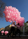 Hundreds of pink balloons sofia bulgaria october girls are carrying to a place in center sofia where they will be released in Royalty Free Stock Photography