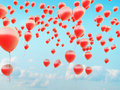 Hundreds of the red flying balloons small Royalty Free Stock Image