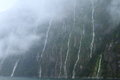 Hundreds waterfalls flowing mountains rainstorm fiordland national park new zealand Royalty Free Stock Images