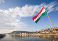 The Hungarian flag over river Danube. Stock Photos