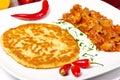 Hungarian goulash with potato pancakes Royalty Free Stock Photo