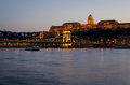 Hungarian landmarks, Chain Bridge, Royal Palace and Danube river in Budapest at night. Royalty Free Stock Photo