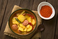 Hungarian paprikas krumpli potato with paprika a bowl of the dish called a stew made of onion pepper tomato and sausage Royalty Free Stock Images