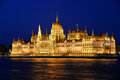 Hungarian parliament building in budapest by night on the bank of the danube Stock Photo