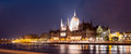 Hungarian parliament building during nighttime panorama of the Royalty Free Stock Image