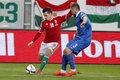 Hungary vs greece uefa euro qualifier football match budapest march hungarian zoltan stieber l crosses the ball next to greek Stock Image