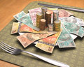 Hunger for money dinner time with brazilian on the plate Stock Photo