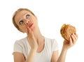 Hungry beautiful girl eats a tasty hamburger Stock Image
