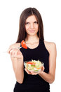 Hungry beautiful healthy woman holding salad on white background Royalty Free Stock Photo