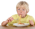 Hungry blond boy Royalty Free Stock Photo