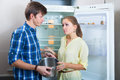 Hungry couple near empty fridge Royalty Free Stock Photo