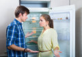 Hungry couple standing near empty shelves Royalty Free Stock Photo