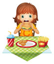 A hungry little girl eating