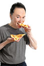 Hungry man eating delicious italian pizza studio portrait white background Stock Photos