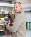 Hungry man and refrigerator Royalty Free Stock Photo
