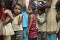 Hungry nepalese children waiting in a food line Royalty Free Stock Photo