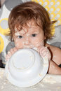 Hungry soiled kid. Royalty Free Stock Photo