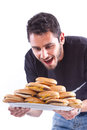 So hungry a young happy man holding a plate full of cheesburger cheeseburger to be exact Royalty Free Stock Images