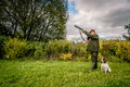 Hunter aiming with dog with his rifle Royalty Free Stock Images