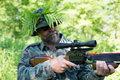 Hunter aims a crossbow in camouflage focus on the Stock Images