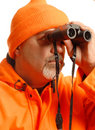 Hunter with binoculars Stock Images