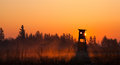 Hunter lookout tower on the edge of the forest in morning mist Royalty Free Stock Photo