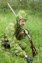 Hunter with an old rifle is considering the trail Royalty Free Stock Photos
