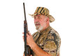 Hunter with rifle close up of an older holding a ready to shoot isolated on white Stock Photo