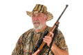 Hunter with rifle close up of an older holding a ready to shoot isolated on white Stock Photos