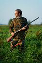 Hunter with rifle gun Royalty Free Stock Photo