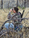 Hunter scouting with binoculars Stock Photos