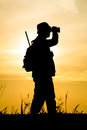 Hunter with shotgun in sunset on the field Stock Images