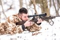 Hunter with a sniper rifle shooting during open season Royalty Free Stock Photo