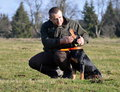Hunter strokes his dog Royalty Free Stock Photo