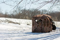 Hunting blind portable with wheeler on a snowy meadow Stock Images