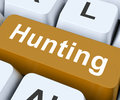 Hunting key means exploration or searching on keyboard meaning seeking Royalty Free Stock Photo