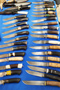 Hunting knives on blue Royalty Free Stock Photo
