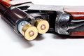 Hunting shotgun and ammunition on white background. Royalty Free Stock Photo