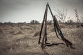 Hunting shotguns in dry rural field in overcast day with dramatic sky during hunting season as hunting background with copy space Royalty Free Stock Photo